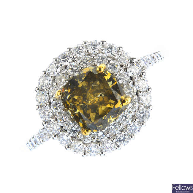 A Fancy Dark Brown-Greenish Yellow diamond and diamond cluster ring.
