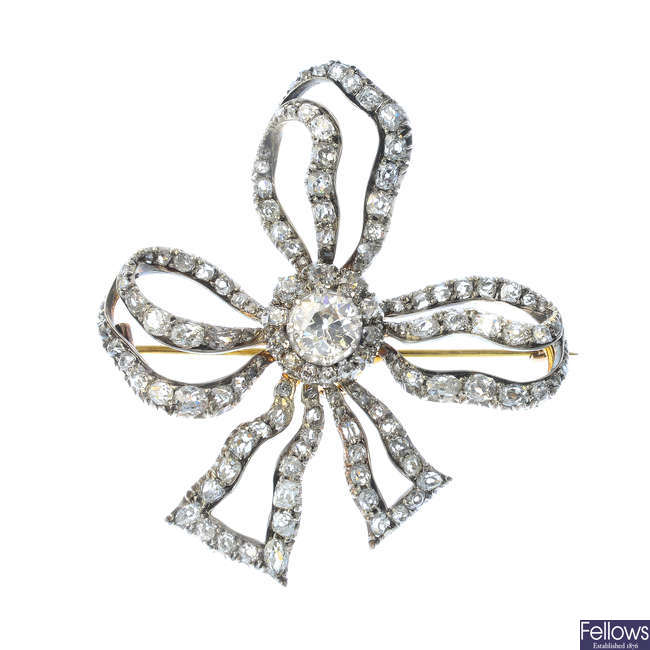 A late Victorian silver and gold diamond bow brooch.