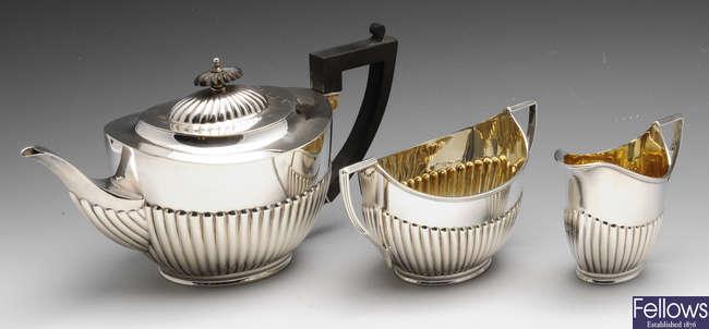 A matched early twentieth century three piece silver tea service.