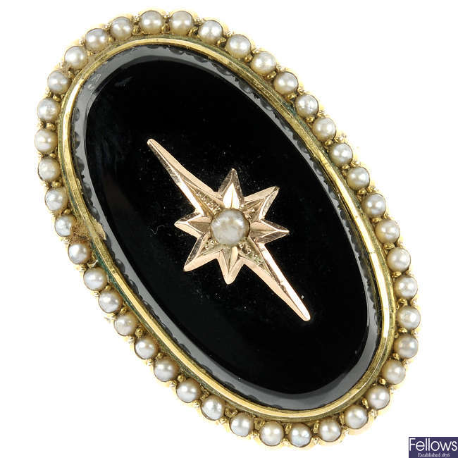 A late Victorian 9ct gold onyx and split pearl memorial ring.