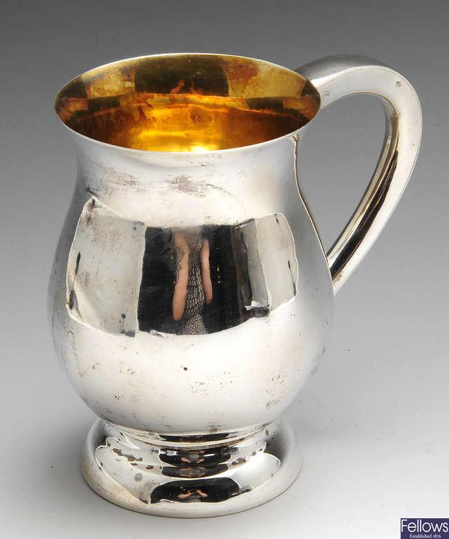 A modern silver mug.