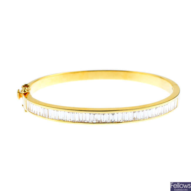 A diamond hinged bangle.