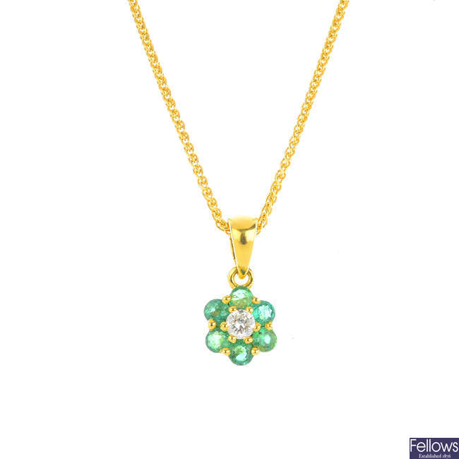 An 18ct gold emerald and diamond pendant, with 18ct gold chain.