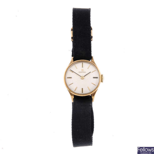 OMEGA - a lady's 9ct yellow gold wrist watch.