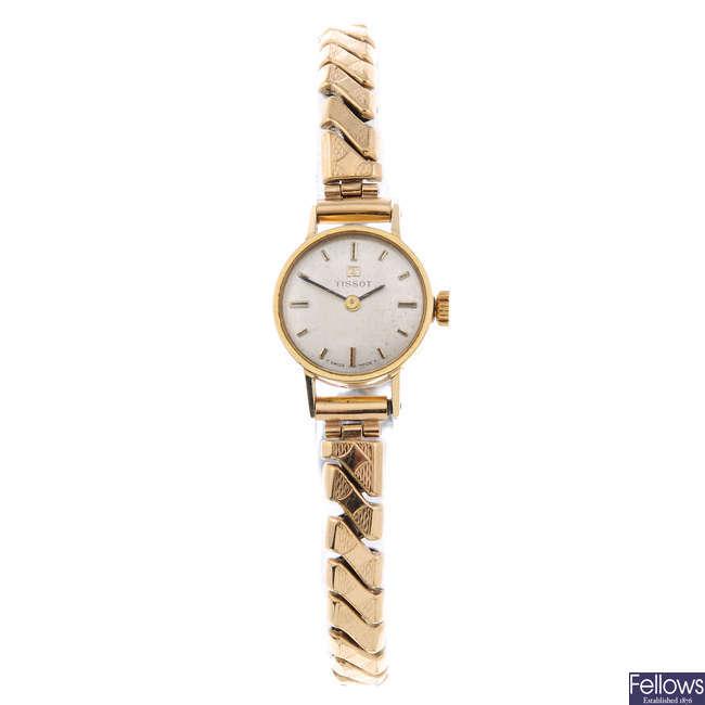 TISSOT - a lady's 9ct yellow gold bracelet watch.