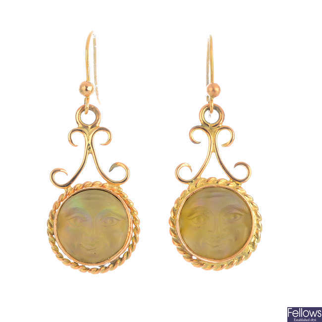 A pair of 'Man in the Moon' earrings.