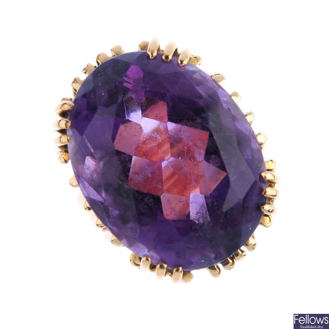 An amethyst dress ring.
