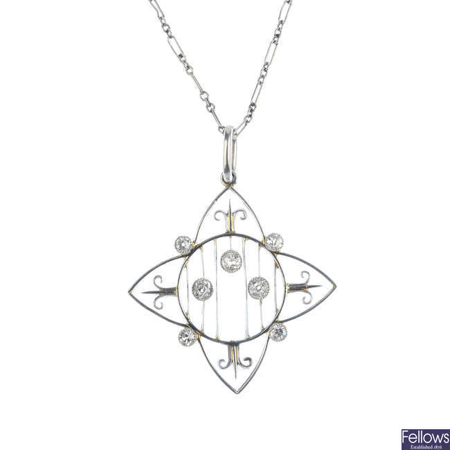 An Edwardian platinum and diamond pendant, with platinum chain.