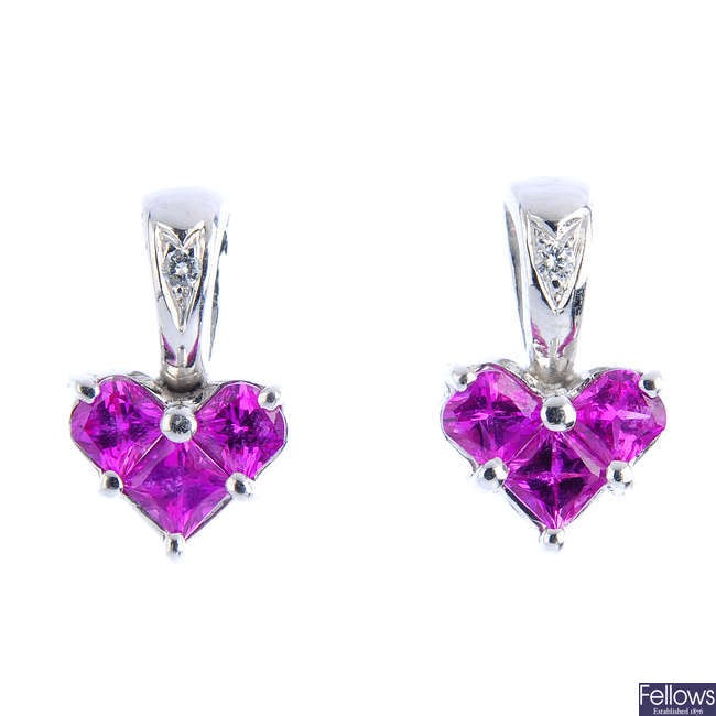 A pair of synthetic ruby and diamond stud earrings.