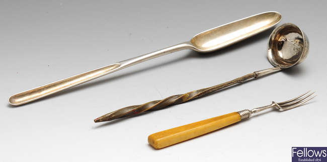 An early Georgian silver marrow scoop, a William IV silver toddy ladle & a George IV silver pickle fork. (3).