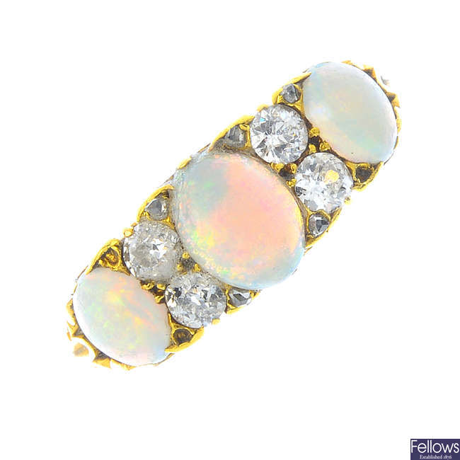 A late Victorian 18ct gold opal and diamond three-stone ring.