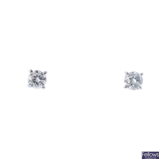 A pair of 9ct gold diamond stud earrings.