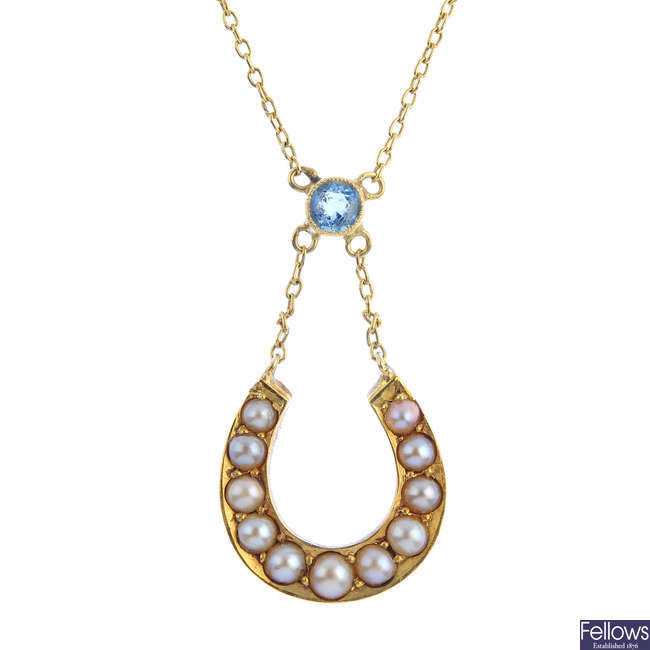 An early 20th century gold split pearl and aquamarine necklace.