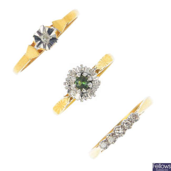 Three diamond and peridot rings.