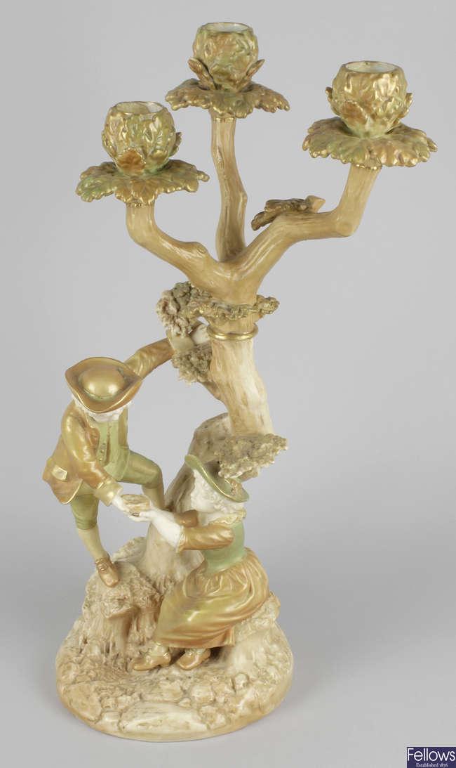 A Royal Worcester James Hadley porcelain figure group.