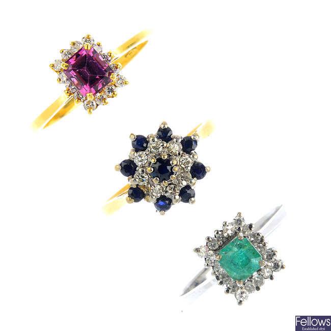 Three diamond, emerald, sapphire and garnet cluster rings.