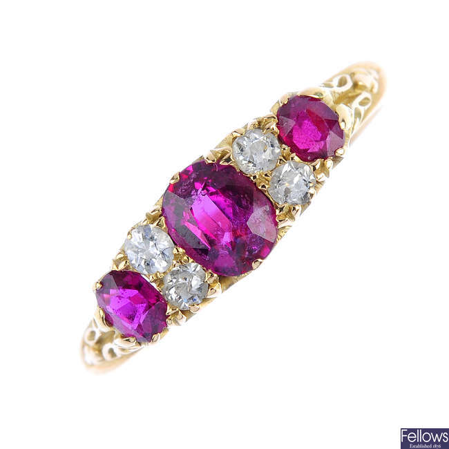 An early 20th century 18ct gold ruby three-stone and diamond ring.