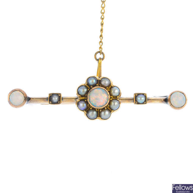 An early 20th century gold opal and split pearl brooch.