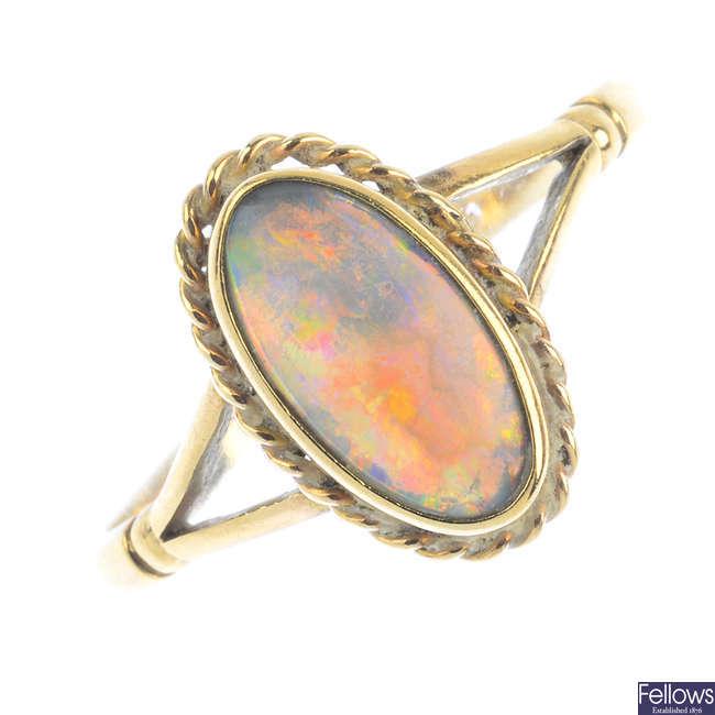 An opal single-stone ring.