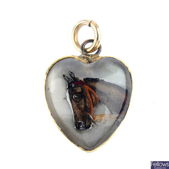 A late Victorian gold horse reverse-carved intaglio pendant.