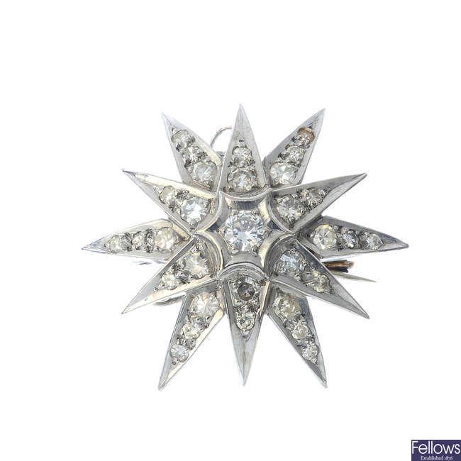 A diamond star pendant.