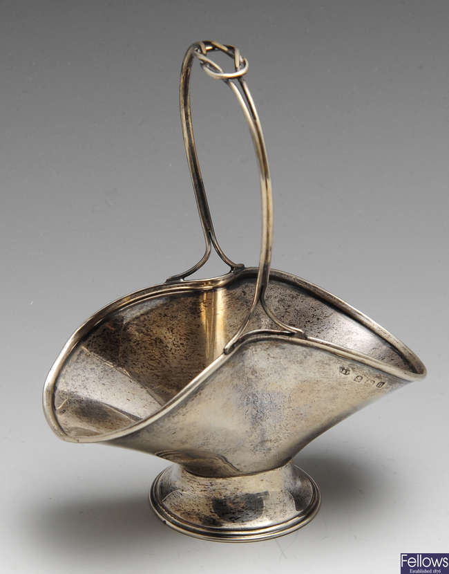 An early twentieth century silver bonbon dish, three silver napkin rings & a pair of open salts.