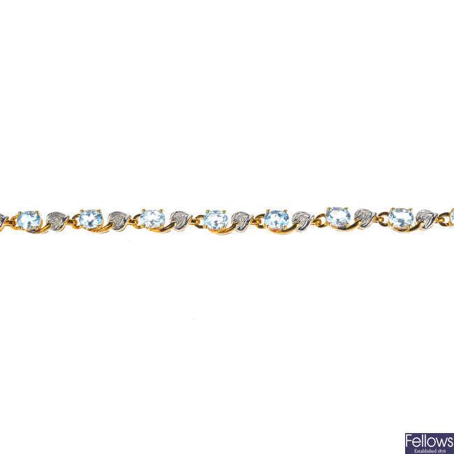 A 9ct gold topaz and diamond bracelet.
