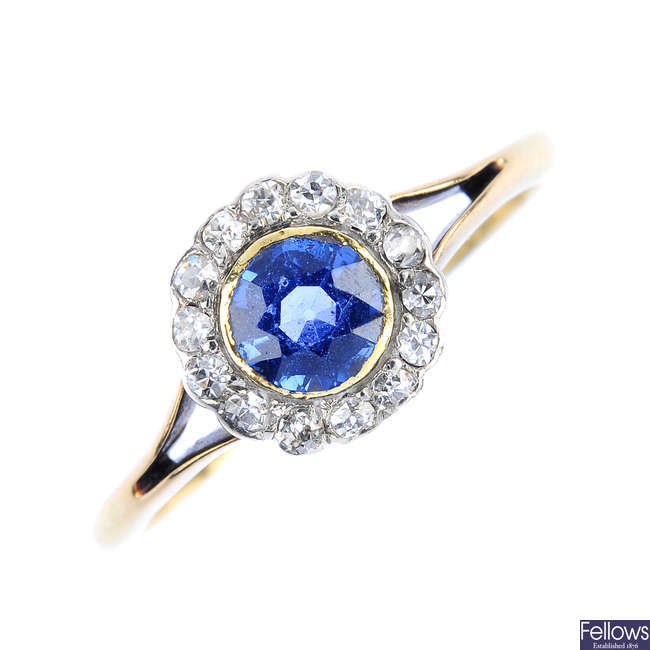 An early 20th century 18ct gold sapphire and diamond cluster ring.