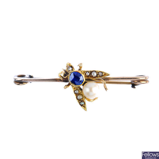A late Victorian gold, sapphire and split pearl fly brooch.