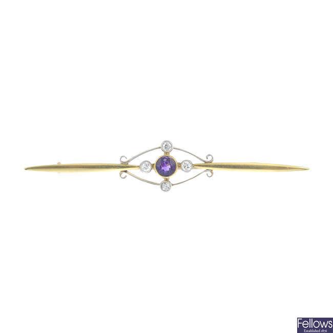 An early 20th century amethyst and diamond bar brooch.