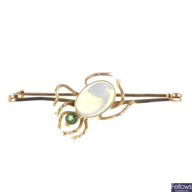 A gem-set spider brooch.