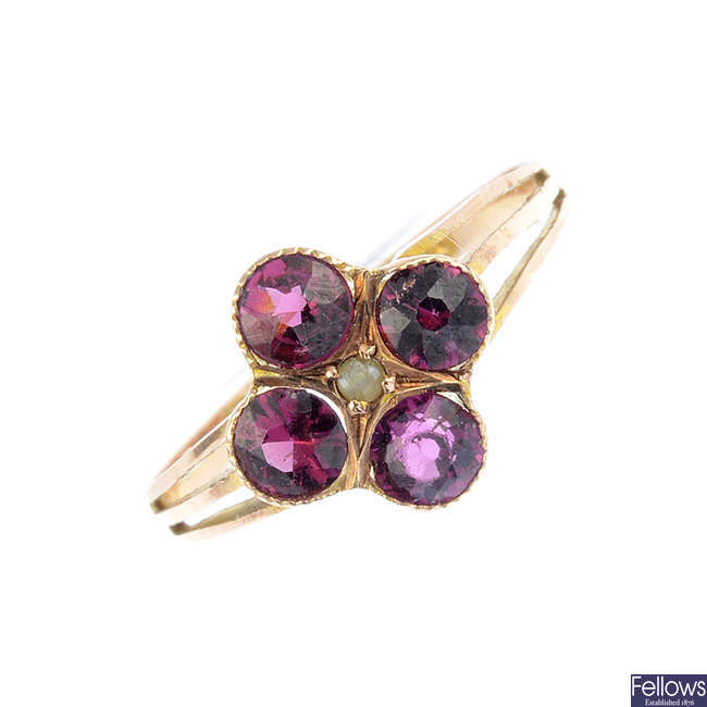 An early 20th century 9ct gold garnet and split pearl ring.