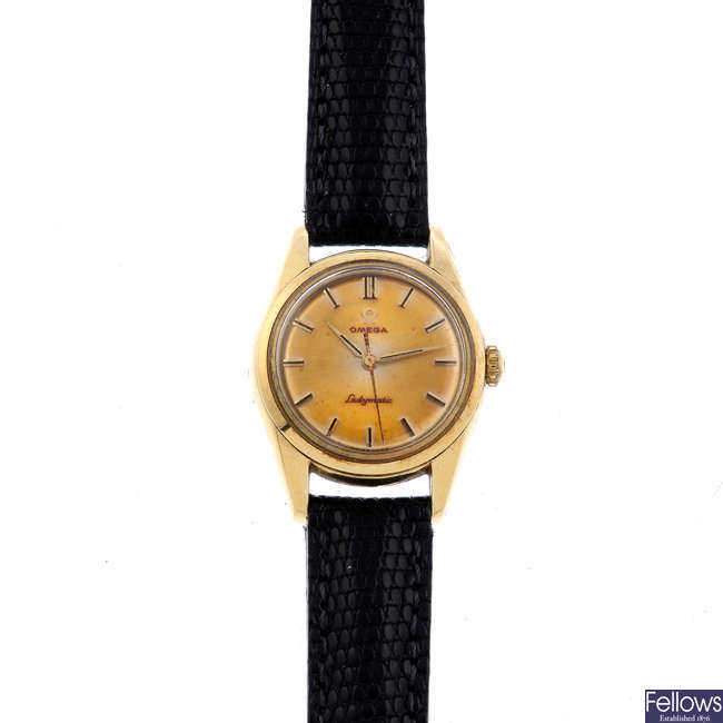 OMEGA - a lady's gold plated Ladymatic wrist watch with an Omega De Ville watch head.