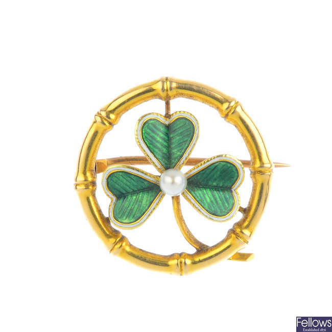 An early 20th century gold enamel and seed pearl shamrock brooch.