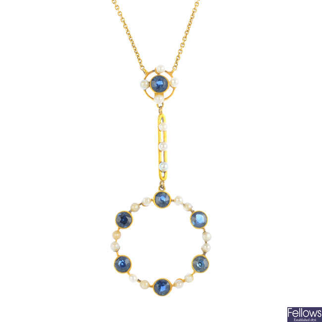 An Edwardian gold sapphire and seed pearl pendant, with chain.