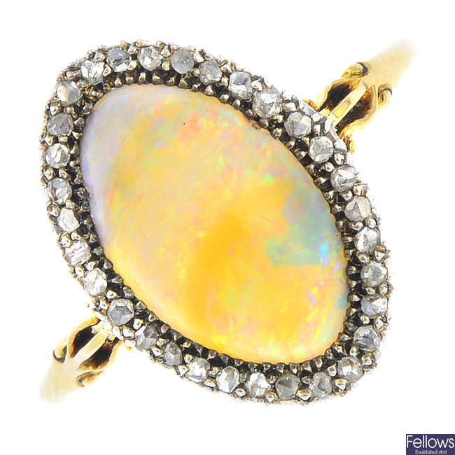An early 20th century silver and 18ct gold, opal and diamond cluster ring.