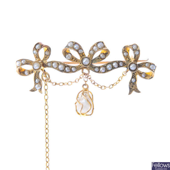 An early 20th century split pearl and baroque cultured pearl brooch.