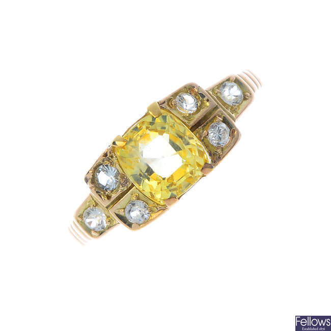 A yellow and colourless sapphire dress ring.
