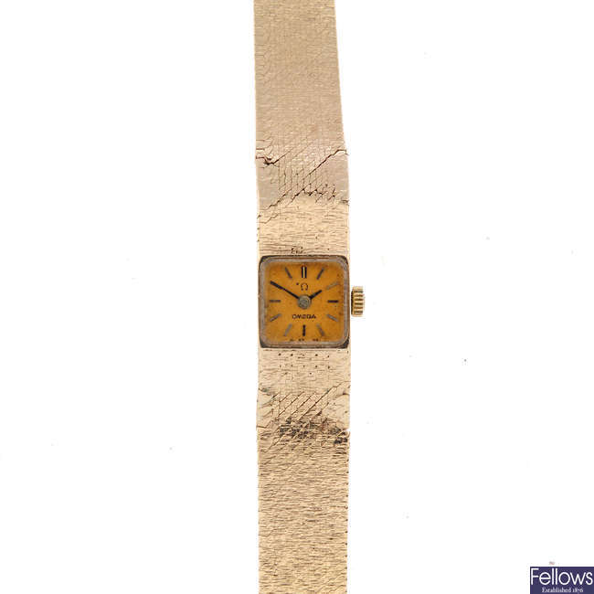 OMEGA - a lady's 9ct yellow gold bracelet watch.