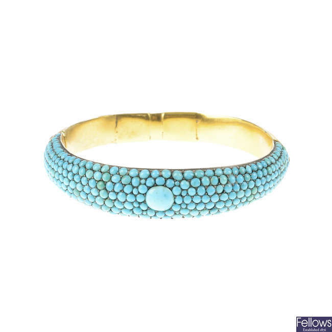 A late Victorian gold and turquoise hinged bangle.
