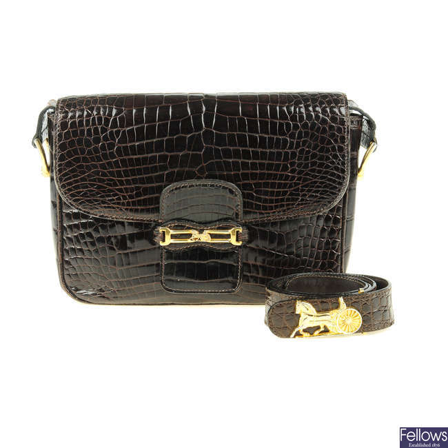 CÉLINE - a vintage crocodile handbag with matching belt.