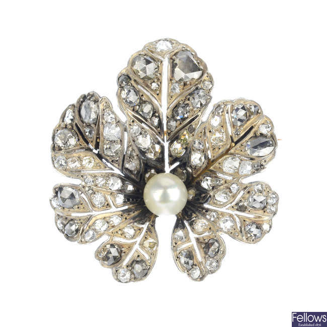 An early 20th century silver and gold, cultured pearl and diamond brooch.