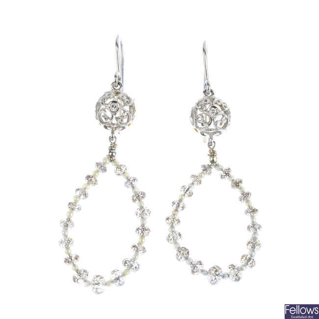 A pair of diamond and seed pearl earrings.