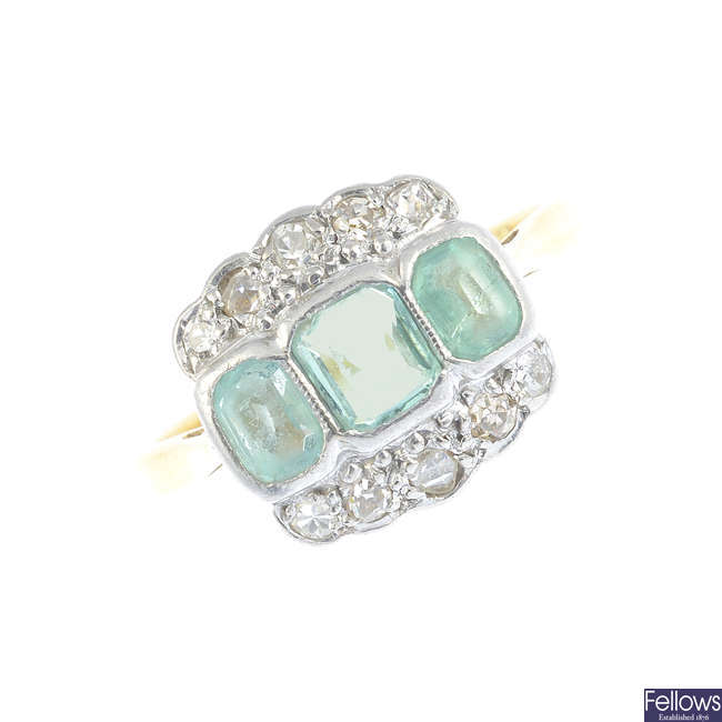 An early 20th century platinum and 18ct gold emerald and diamond dress ring.