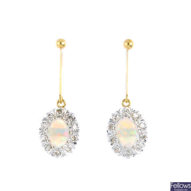 A pair of opal and diamond earrings.