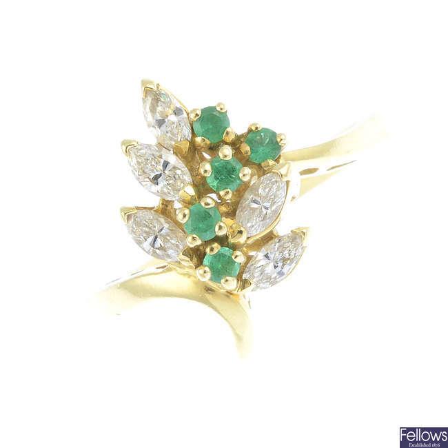 An emerald and diamond dress ring.
