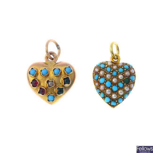 Two gem-set pendants.