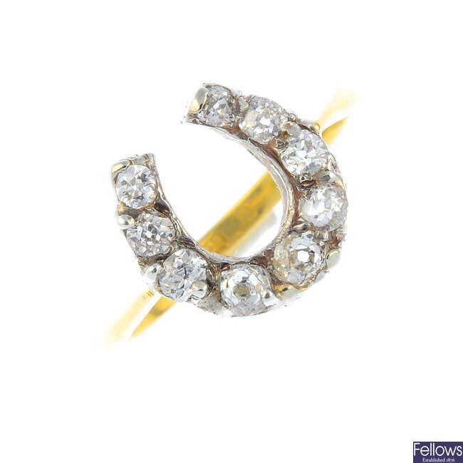 An early 20th century diamond horseshoe ring.