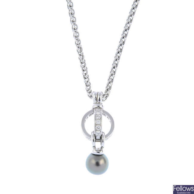 GARRARD - an 18ct gold cultured pearl and diamond pendant, on chain.