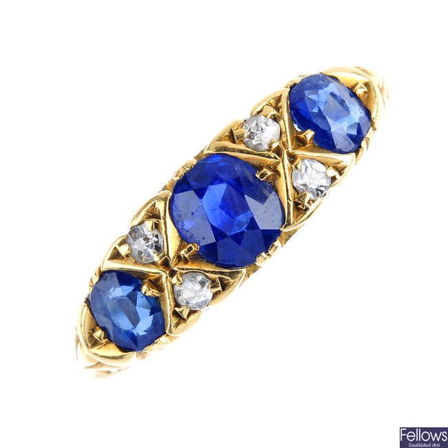 An Edwardian 18ct gold sapphire three-stone and diamond ring.